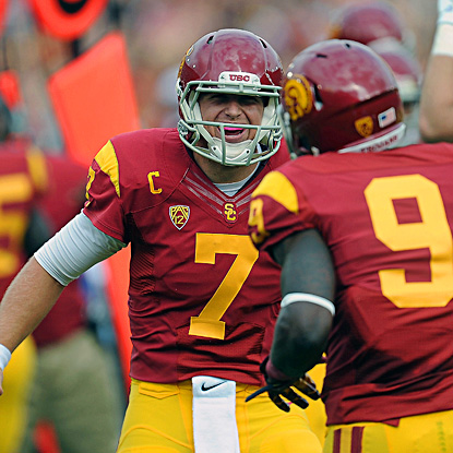 Matt Barkley celebrates with Marqise Lee following one of Barkley's five first-half touchdowns. He finishes with six. (US Presswire)