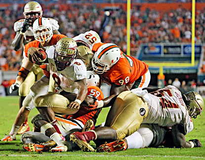 Devonta Freeman scores one of two fourth-quarter touchdowns against Miami. (US Presswire)