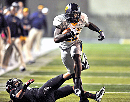 David Fluellen runs for a first down in the fourth quarter as Toledo knocks off previously unbeaten Cincinnati. (AP)