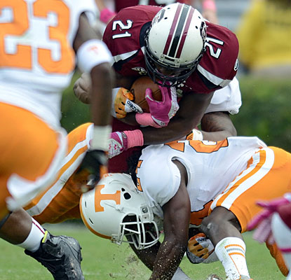 Marcus Lattimore's right leg buckles during a second-quarter run, leading to his being carted off the field.  (AP)