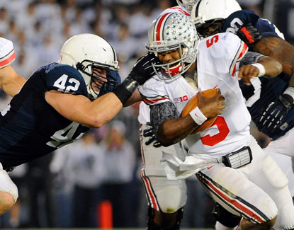 Quarterback Braxton Miller reaches 100 yards rushing for the sixth time this season, carrying 25 times. (US Presswire)