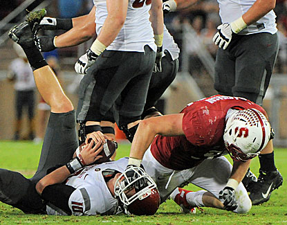 Stanford sacks Jeff Tuel 10 times, including this takedown by Cardinal DE Henry Anderson. (US Presswire)