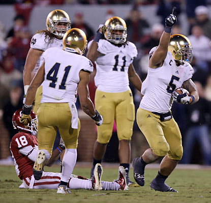 Manti Te'o celebrates an interception late in the fourth to help Notre Dame seal its best start in a decade. (US Presswire)