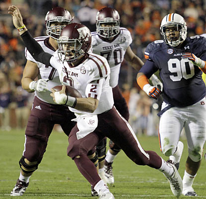 Johnny Manziel has five TDs (three on the ground and two in the air) as A&M scores the most points on Auburn since 1917. (US Presswire)