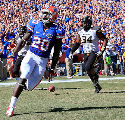 Omarius Hines makes the most out of his one carry as he crosses the goal line in the third quarter to tie up the game for UF. (Getty Images)