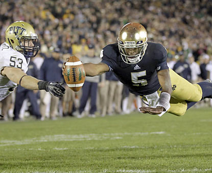 Everett Golson dives into the end zone late in the fourth to even the game at 20 apiece. The Irish go on to win in 3OT. (AP)