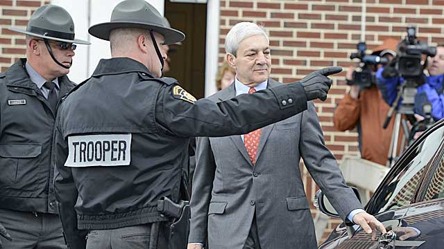 Spanier leaves Harrisburg District Judge William Wenner's office Wednesday (AP)
