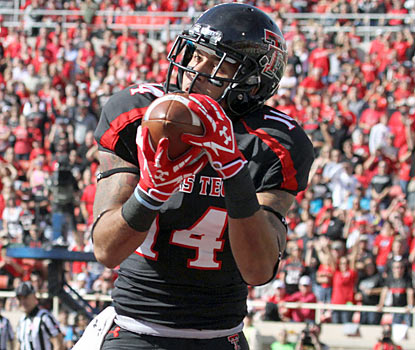 Darrin Moore hauls in a game-winning touchdown in double overtime to lead Texas Tech to its seventh win of the season. (US Presswire)