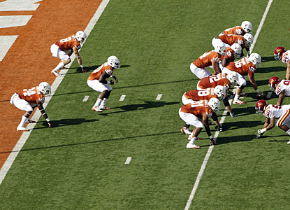 Texas runs its first play out of the wishbone, one of former coach Darrell Royal's innovations.  (AP)