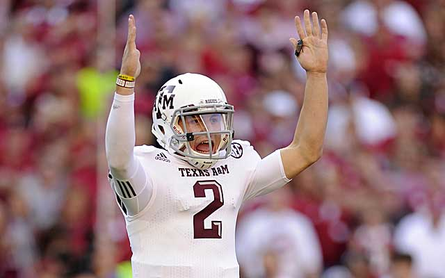 Johnny Football signals for a TD while taking apart the Bama defense. (US Presswire)