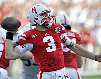 Taylor Martinez finishes with 171 yards through the air and also runs for 104 in the Cornhuskers' win. (AP)
