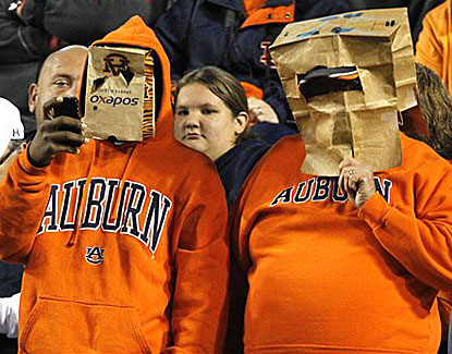 Auburn fans don paper bags on their heads in a show of disgust over their team's performance. (AP)