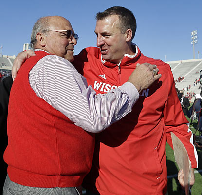 Wisconsin coach Bret Bielema (right) celebrates as his team earns a trip back to the Big Ten title game. (AP)