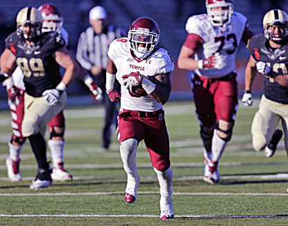 Temple's Montel Harris runs for one of his seven touchdowns against Army. (AP)