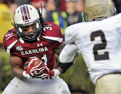 Kenny Miles rushes for a career-high 127 yards and a touchdown in the Gamecocks' win over Wofford. (AP)