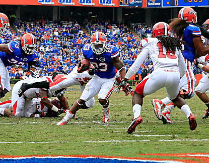 Florida's Mike Gillislee scores the Gators' first points of the game on a seven-yard run in the first quarter. (Getty Images)