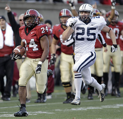 Harvard running back Treavor Scales sprints down the sideline for a game-clinching 63-yard touchdown.  (AP)