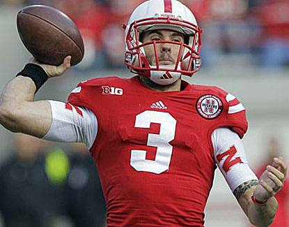 Nebraska's Taylor Martinez throws for 308 yards and two scores, becoming the Huskers' all-time passing leader. (AP)