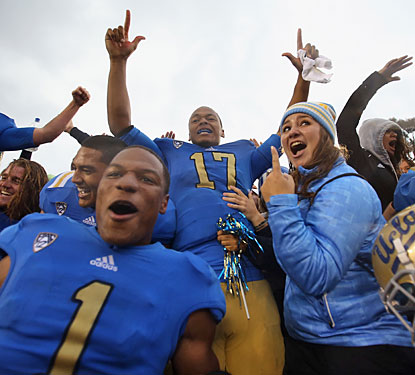 Brett Hundley (17) leads the celebration after UCLA ends its five-game losing streak against the rival Trojans.  (Getty Images)