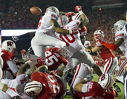 Wisconsin's Montee Ball fumbles on what would have been a record-breaking score. He earlier tied the record with his 78th TD. (US Presswire)