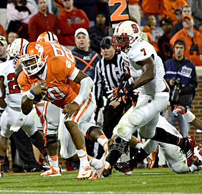 Tajh Boyd, who tosses five touchdown passes, runs in for one of his three rushing scores against N.C. State. (AP)