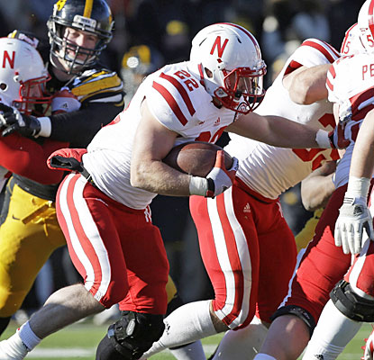 After missing four games, Rex Burkhead steps in to gain 69 yards and score Nebraska's only touchdown.  (AP)