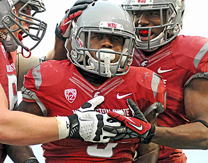 Carl Winston runs for three touchdowns for Washington State, matching the Cougars entire season total. (US Presswire)