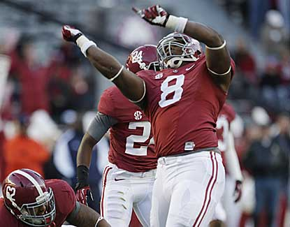 Alabama defensive lineman Jeoffrey Pagan celebrates after making a tackle for a loss vs. Auburn. (US Presswire)