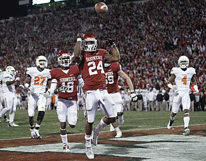 Oklahoma running back Brennan Clay tosses the football after scoring the game-winning touchdown. (US Presswire)