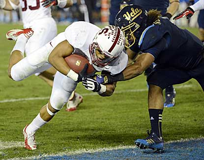 Stanford cornerback Usua Amanam returns a fumble for a score in the Cardinal's win over UCLA. (US Presswire)