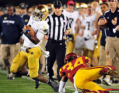 Notre Dame RB Theo Riddick rumbles for 146 yards and a touchdown for the title game-bound Irish. (US Presswire)