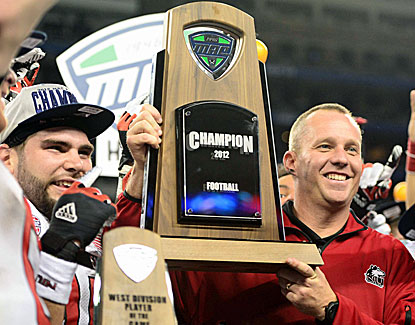 Northern Illinois coach Dave Doeren holds the title trophy after defeating Kent State. His team has a shot at a BCS bowl. (US Presswire)