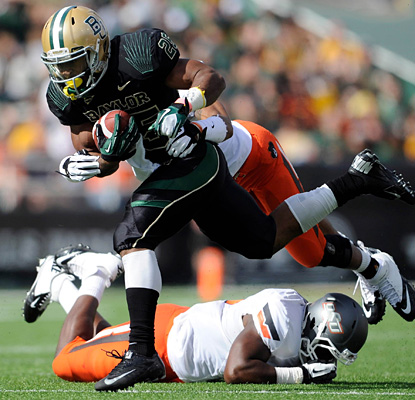 Lache Seastrunk blitzes Oklahoma State for 178 rushing yards, 76 on one TD run in the fourth quarter.  (US Presswire)