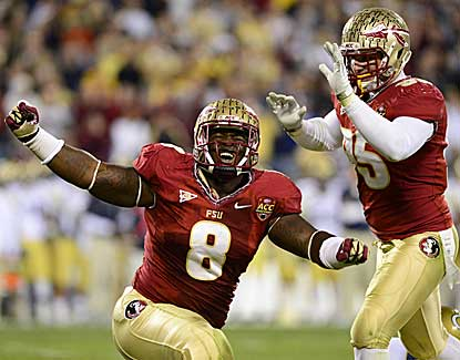 Florida State defensive linemen Timmy Jernigan (8) and Bjoern Werner celebrate a sack on Saturday. (US Presswire)