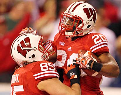 Wisconsin's James White and Brian Wozniak celebrate White's touchdown in the Big Ten title game. (US Presswire)