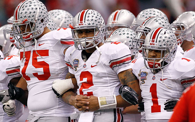 Mike Adams, Terrelle Pryor and Daniel Herron helped bring the NCAA hammer down on Ohio State. (Getty Images)