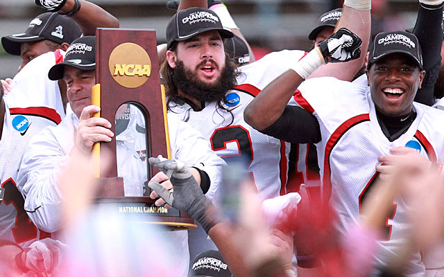 Valdosta State coach David Dean (with trophy) and the Blazers celebrate their national title. (US Presswire)