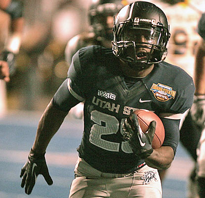 Game MVP Kerwynn Williams runs for 235 yards and three TDs to help Utah State win its first bowl game since 1993. (AP)