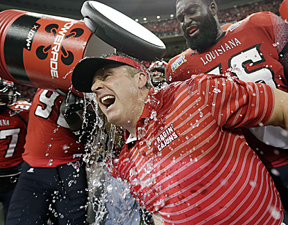 Louisiana-Lafayette coach Mark Hudspeth is dunked at the end of the Ragin' Cajuns' 43-34 win over East Carolina. (AP)