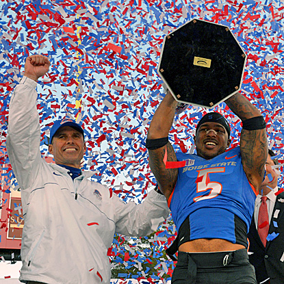Boise State coach Chris Petersen (left) and Jamar Taylor hoist the Maaco Bowl trophy after their win over the Huskies. (US Presswire)