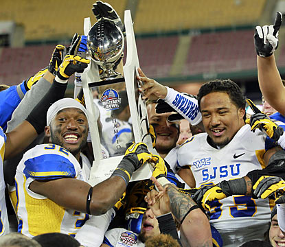 San Jose State players hoist a trophy as they rejoice their Military Bowl victory over Bowling Green. (US Presswire)