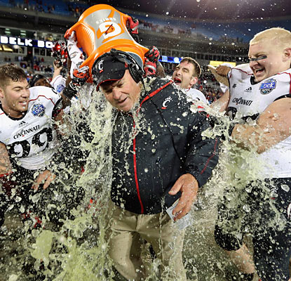 The Bearcats give interim head coach Steve Stripling a postgame shower following their win in the Belk Bowl. (Getty Images)