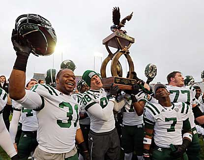 Several Ohio Bobcats players celebrate their 45-14 win over La.-Monroe in the Independence Bowl. (US Presswire)