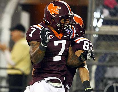 Virginia Tech's Marcus Davis (7) and Corey Fuller celebrate Fuller's game-tying TD against Rutgers. (US Presswire)