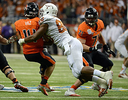 Alex Okafor is a menace for the Longhorns, logging 4 1/2 sacks against Oregon State in the Alamo Bowl. (US Presswire)