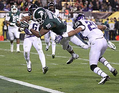Michigan State wide receiver Aaron Burbridge dives over the goal line for a 16-yard touchdown. (AP)