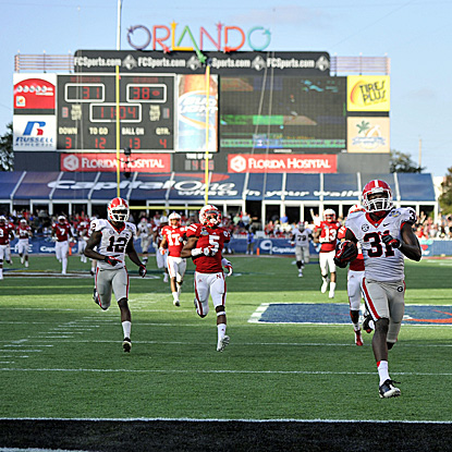 Georgia's Chris Conley (right) (two catches for 136 yards) scores one of his two touchdowns. (US Presswire)