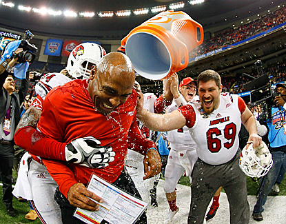 Louisville coach Charlie Strong, the one-time defensive coordinator at Florida, celebrates the Cardinals' Sugar Bowl win. (Getty Images)