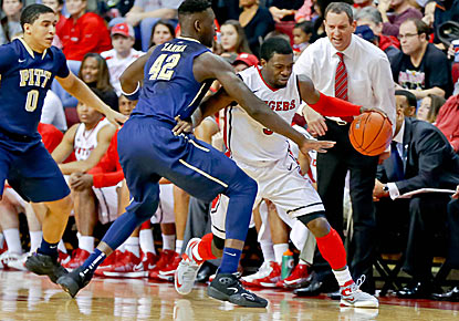 Eli Carter makes a move during the Scarlet Knights' victory over Pitt on Saturday. Carter scored 23 points off the bench.  (US Presswire)