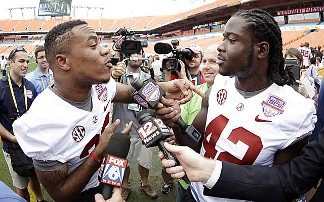 Alabama players Eddie Lacy and Christion Jones interview each other at BCS media day. (AP)